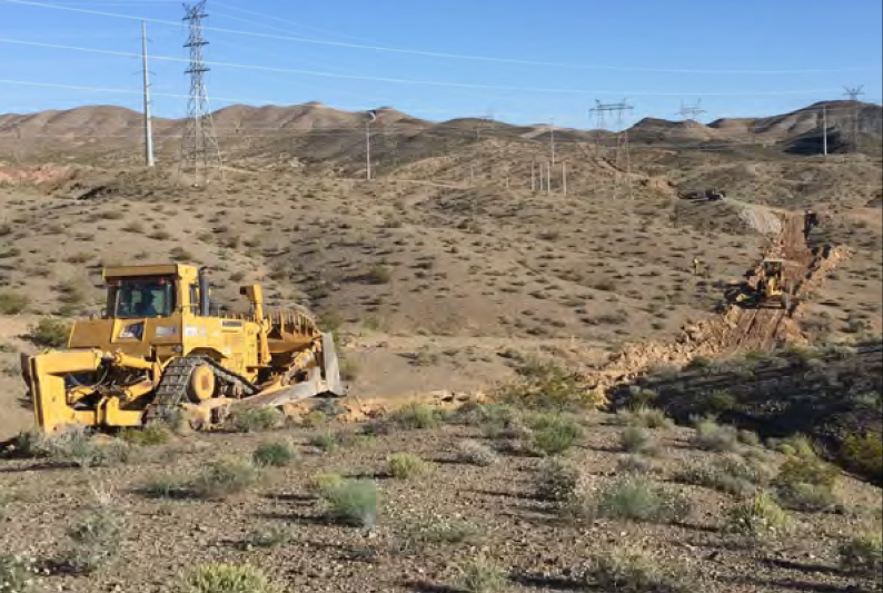 Construction vehicles clearing land for the Boulder City bypass