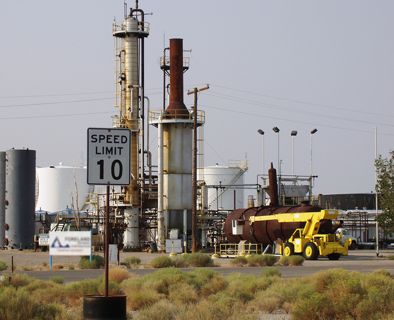 An industrial plant with towers, tanks, and heavy equipment